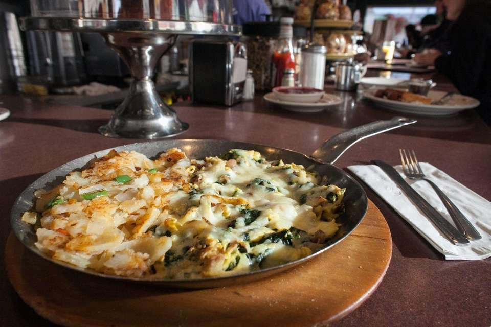 A Popeye scramble of eggs, cheese and spinach
