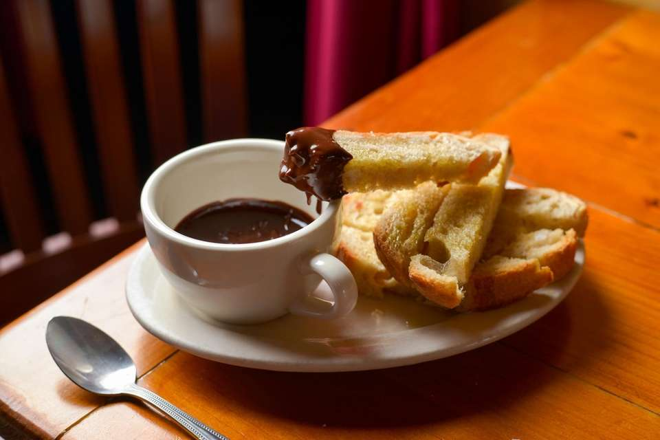 Dark chocolate fondue with nutella and is served