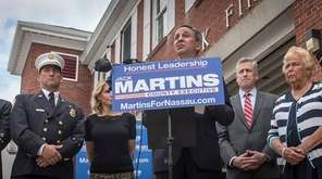 GOP Nassau County Executive candidate Jack Martins, center,
