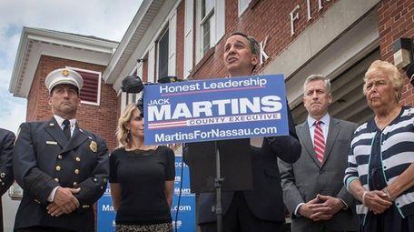 GOP Nassau County Executive candidate Jack Martins, center,