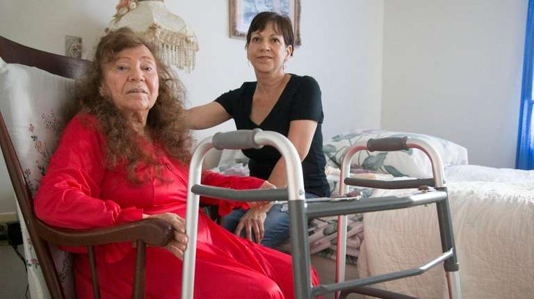 Lydia Rodriguez, sitting with her daughter Nancy Geyer