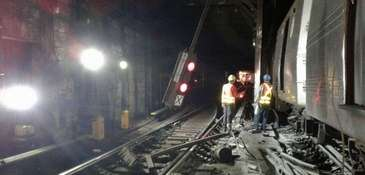 Workers at the 125th Street station in Harlem