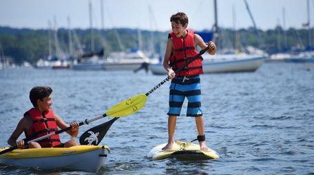 Alex Argyros, 13, of Port Washington, center, and