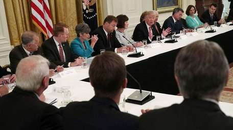 President Donald Trump meets with Senate Republicans on