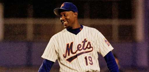 Mets pitcher Anthony Young laughs between innings of