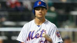 Michael Conforto of of the Mets strikes out in