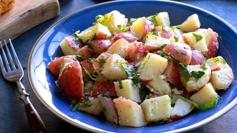 Red potatoes are boiled and tossed with a
