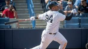 Yankees prospect Miguel Andujar hits a double during a spring training