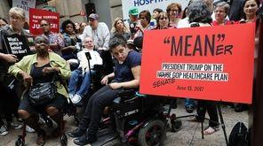 Doctors, nurses, patients and activists listen as