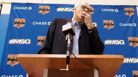 Phil Jackson speaks to reporters in an end-of