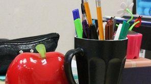 An apple on a teacher's desk.