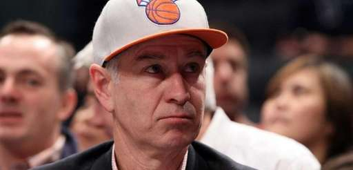 John McEnroe attends the NBA game between the
