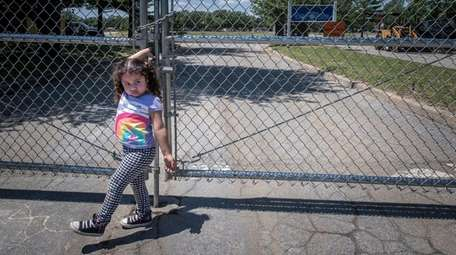 Brentwood resident Miley Chavez, 3, pulls at the