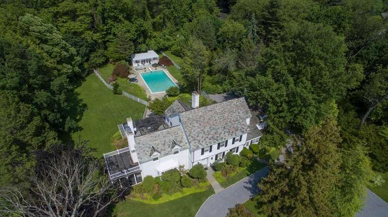 The 1937 Colonial comes with two subdividable tracts,