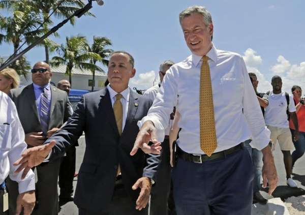 New York City Mayor Bill de Blasio, right,
