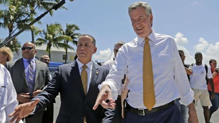 New York City Mayor Bill de Blasio, right,