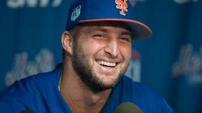 Mets outfielder and former NFL quarterback Tim Tebow