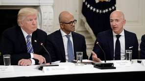 President Donald Trump meets with, from left, Microsoft