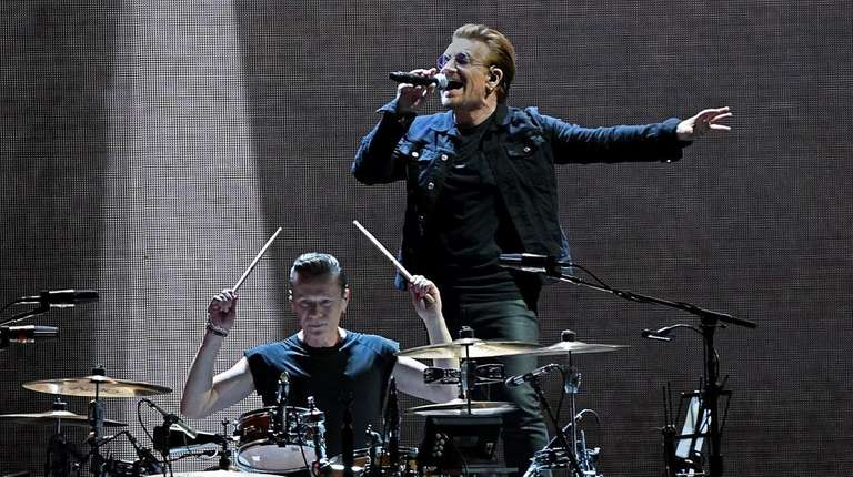 U2's Larry Mullen Jr. and Bono perform during