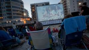 Moviegoers in Long Beach watch