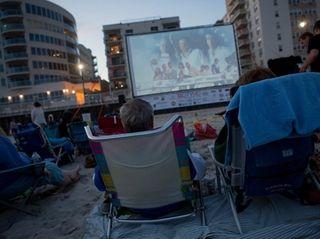 Moviegoers in Long Beach watch