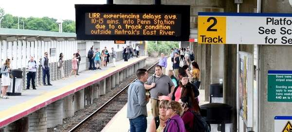 Commuters at the Ronkonkoma LIRR station wait as