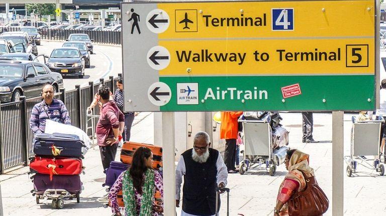 Travelers arrive and depart at Terminal 4 at