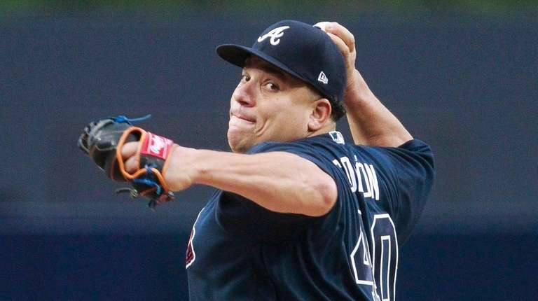 Braves' Bartolo Colon pitches against the Padres during