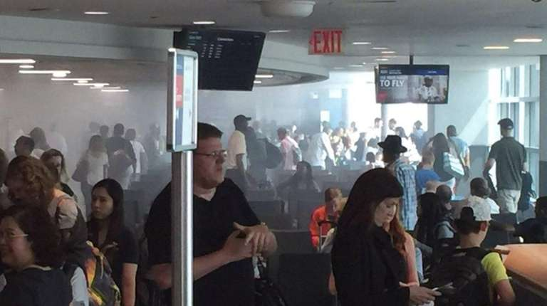 At Kennedy Airport, a restaurant fire filled a