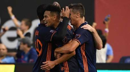 New York City FC players congratulate Alexander Callens