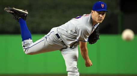 Seth Lugo of the Mets pitches against the