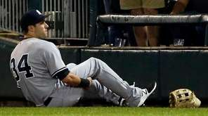 New York Yankees' Dustin Fowler sits on the