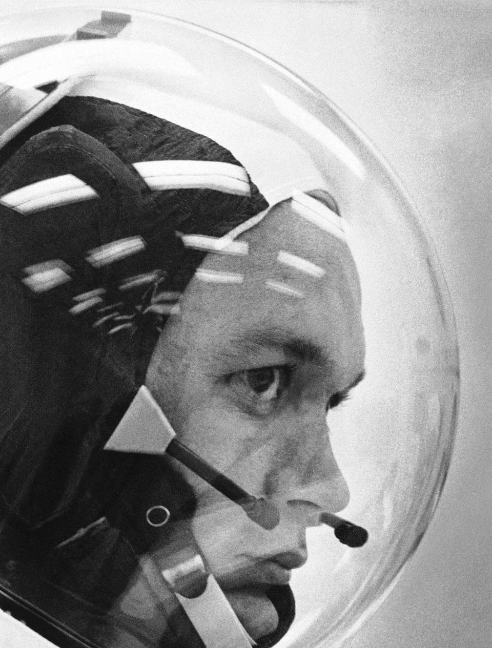 Astronaut Michael Collins wears the space helmet for