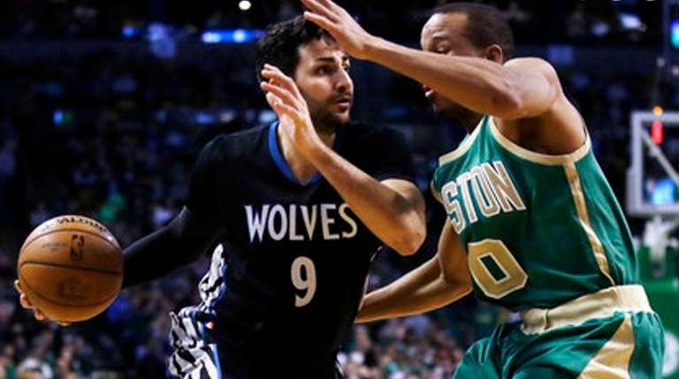 Minnesota Timberwolves' Ricky Rubio tries to drive past
