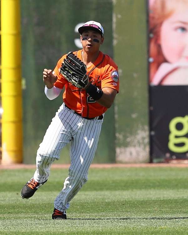Ducks leftfielder Angelo Songco makes a running catch