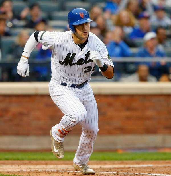 Michael Conforto of the Mets runs out his