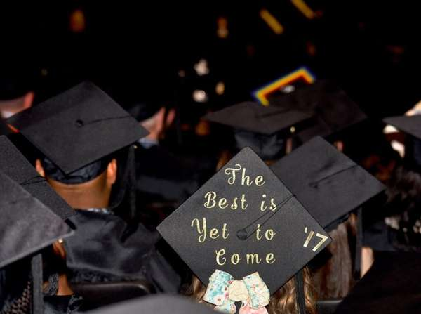 A graduation student wearing a personalized cap.