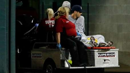 The Yankees' Dustin Fowler is carted off the field