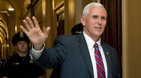 Vice President Mike Pence waves as he walks