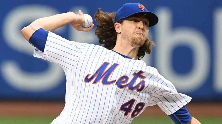 Mets pitcher Jacob deGrom delivers against the Phillies