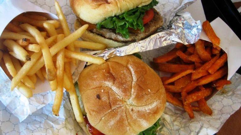 A turkey burger and a classic burger at