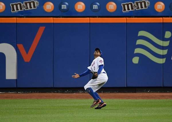 Mets centerfielder Curtis Granderson never saw this fly