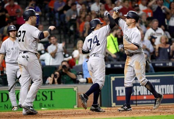 The Yankees' Brett Gardner, right, celebrates with Ronald