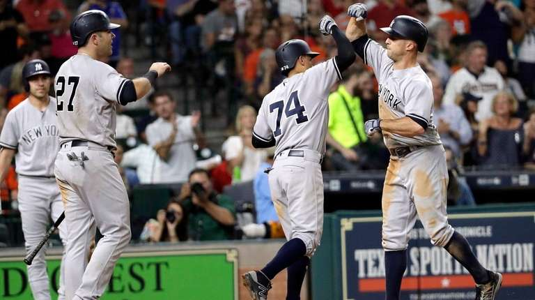 The Yankees' Brett Gardner, right, celebrates with Ronald