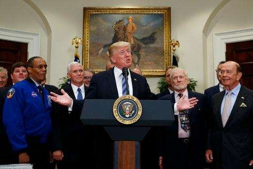 President Donald Trump speaks before signing an executive