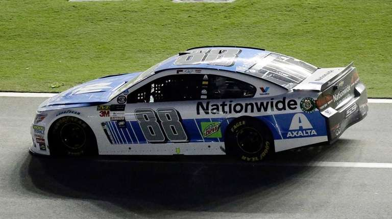 Dale Earnhardt Jr. (88) rolls down pit road
