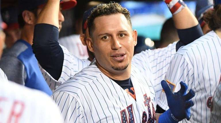 Mets second baseman Asdrubal Cabrera is greeted in