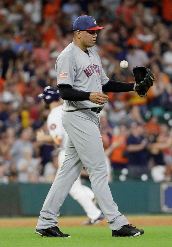 New York Yankees relief pitcher Dellin Betances tosses