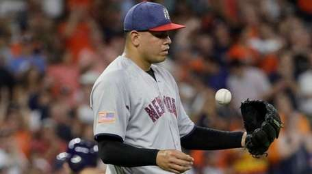 New York Yankees relief pitcher Dellin Betances tosses