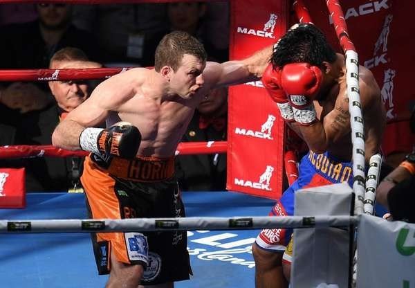 Jeff Horn of Australia and Manny Pacquiao exchange